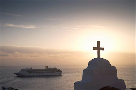View of church and sea ferry at sunset, Oia, Santorini, Cyclades, Greece Stock Photo - Premium Royalty-Free, Code: 649-08086760
