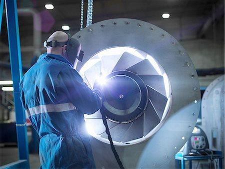Engineer welding airduct part in engineering factory Stock Photo - Premium Royalty-Free, Code: 649-08086789