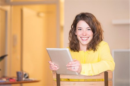 female - Portrait of young woman using digital tablet in kitchen Stock Photo - Premium Royalty-Free, Code: 649-08086923