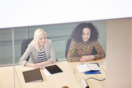 High angle view of businesswomen having meeting at conference table Stock Photo - Premium Royalty-Free, Code: 649-08117807