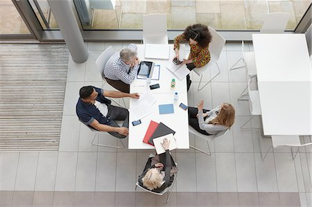 Overhead view of business team having meeting at conference table Stock Photo - Premium Royalty-Free, Code: 649-08117820
