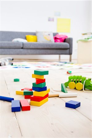 Building blocks and toys on floor Stock Photo - Premium Royalty-Free, Code: 649-08118133