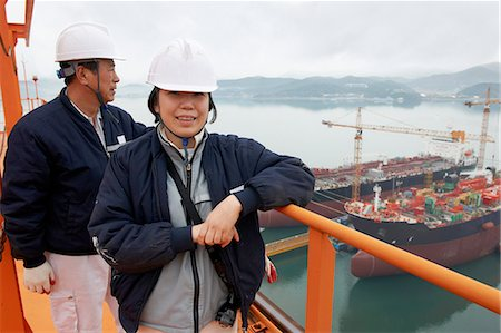 supervising - Portrait of workers at shipping port, GoSeong-gun, South Korea Stock Photo - Premium Royalty-Free, Code: 649-08118244