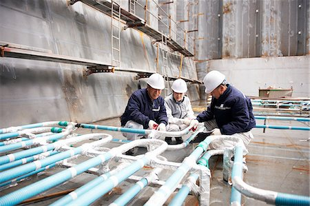 pipework - Workers checking pipework on container ship at shipyard, GoSeong-gun, South Korea Stock Photo - Premium Royalty-Free, Code: 649-08118268