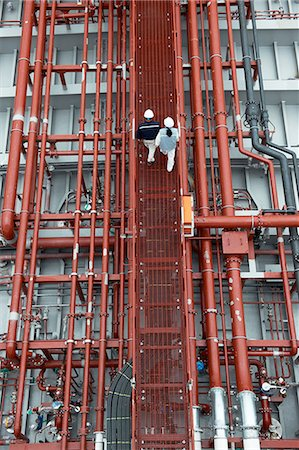 pipework - Workers walking along walkway at shipping port, elevated view, GoSeong-gun, South Korea Stock Photo - Premium Royalty-Free, Code: 649-08118285