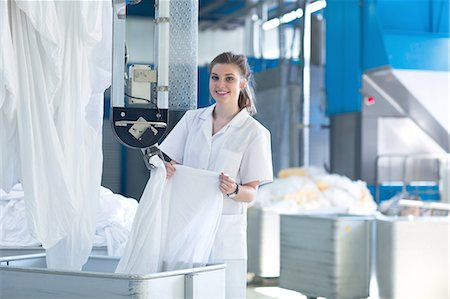 Woman working in laundry Stock Photo - Premium Royalty-Free, Code: 649-08118368