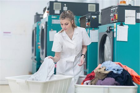 Woman working in laundry Stock Photo - Premium Royalty-Free, Code: 649-08118377