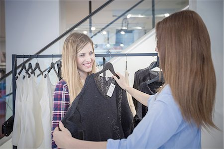 Two female friends shopping for sweater in boutique Stock Photo - Premium Royalty-Free, Code: 649-08118432