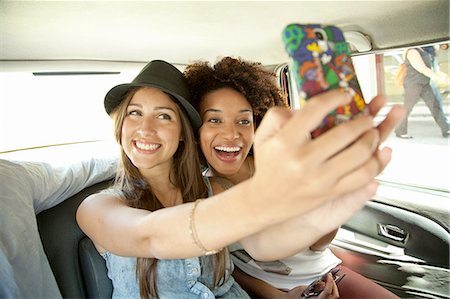 Young women taking photo of themselves in car Stock Photo - Premium Royalty-Free, Code: 649-08118917