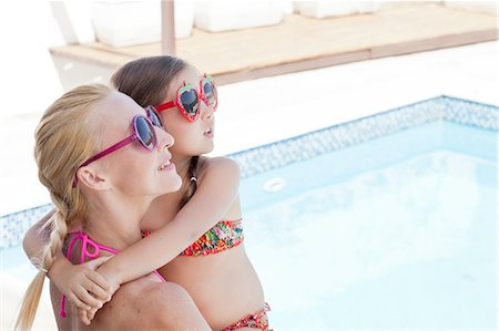 south american woman - Mother and daughter, by side of pool, looking up Stock Photo - Premium Royalty-Free, Code: 649-08119039