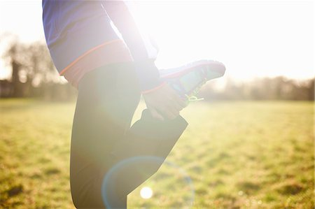 single mature people - Cropped view of mature female runner stretching leg in field Stock Photo - Premium Royalty-Free, Code: 649-08125015