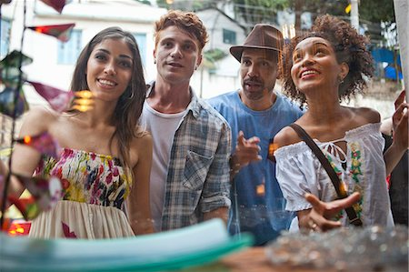 south american woman - Group of friends looking in shop window Stock Photo - Premium Royalty-Free, Code: 649-08125064