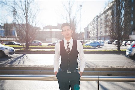 Young businessman in the street, Milan, Italy Stock Photo - Premium Royalty-Free, Code: 649-08125108