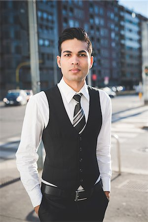 Young businessman in the street, Milan, Italy Stock Photo - Premium Royalty-Free, Code: 649-08125110
