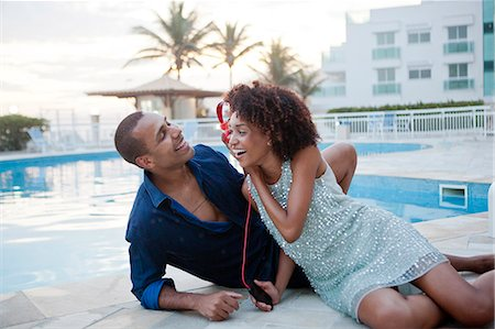 south american woman - Couple sharing headphone music at hotel poolside, Rio De Janeiro, Brazil Stock Photo - Premium Royalty-Free, Code: 649-08125416