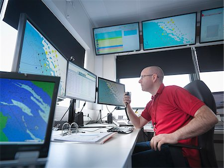 Operator in offshore windfarm control room Stock Photo - Premium Royalty-Free, Code: 649-08125531