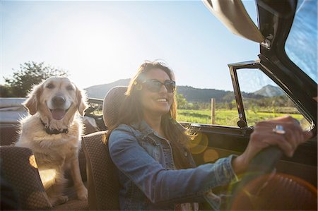 dark glasses - Mature woman and dog, in convertible car Stock Photo - Premium Royalty-Free, Code: 649-08125542