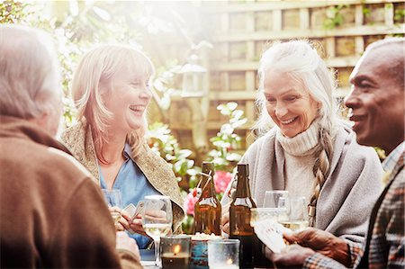 Senior friends playing cards in garden Stock Photo - Premium Royalty-Free, Code: 649-08125765