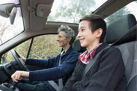 sweater - Mature man and teenage son driving car Stock Photo - Premium Royalty-Free, Code: 649-08125957