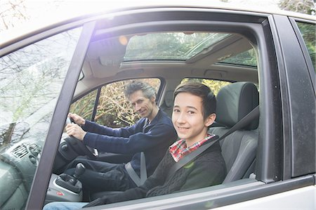sweater - Portrait of mature man and teenage son driving a car Stock Photo - Premium Royalty-Free, Code: 649-08125959