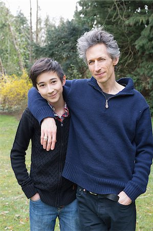sweater - Portrait of mature man and teenage son in garden Stock Photo - Premium Royalty-Free, Code: 649-08125953