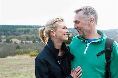 Smiling hiking couple in rural landscape Stock Photo - Premium Royalty-Free, Code: 649-08125978