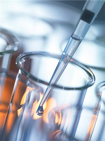 Analytical chemistry, sample being pipetted into a test tube for testing in laboratory Stock Photo - Premium Royalty-Free, Code: 649-08126047
