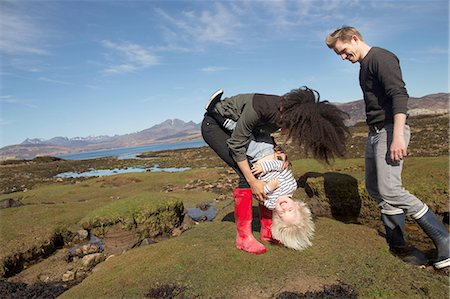 Mother tickling son, Loch Eishort, Isle of Skye, Hebrides, Scotland Stock Photo - Premium Royalty-Free, Code: 649-08144431