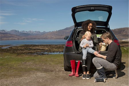 family shoes - Parents helping son change shoes, Loch Eishort, Isle of Skye, Hebrides, Scotland Stock Photo - Premium Royalty-Free, Code: 649-08144452