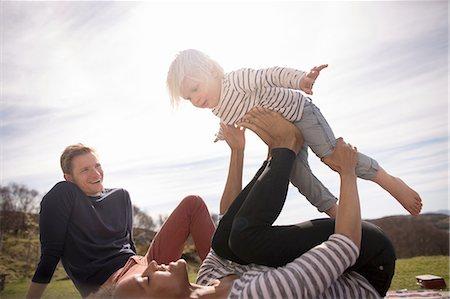 Mother balancing son on feet Stock Photo - Premium Royalty-Free, Code: 649-08144464