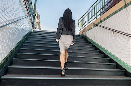 Businesswoman walking up stairs from metro station, Paris, Île-de-France, France Stock Photo - Premium Royalty-Free, Code: 649-08144754
