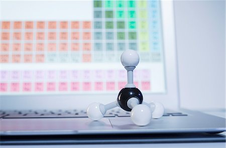 Chemistry research. A ball-and-stick methane molecule model on a laptop computer displaying periodic table elements Stock Photo - Premium Royalty-Free, Code: 649-08144853