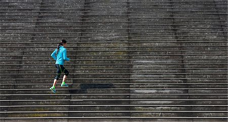 people - Mature female runner running diagonally up wooden stairway Stock Photo - Premium Royalty-Free, Code: 649-08145091