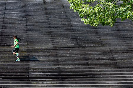 fitness   mature woman - Female runner running diagonally up wooden stairway Stock Photo - Premium Royalty-Free, Code: 649-08145092