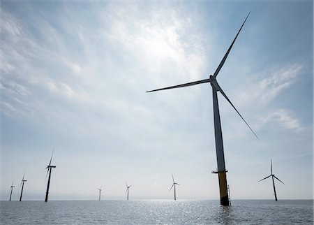 View of silhouetted offshore windfarm from service boat Stock Photo - Premium Royalty-Free, Code: 649-08145119