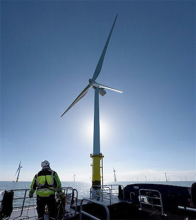 Worker on tender service ship on offshore windfarm Stock Photo - Premium Royalty-Free, Code: 649-08145111