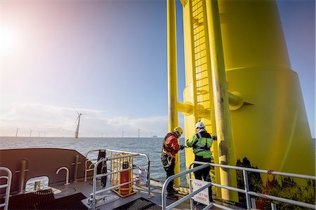 Engineers climbing wind turbine at offshore wind farm Stock Photo - Premium Royalty-Free, Code: 649-08145135
