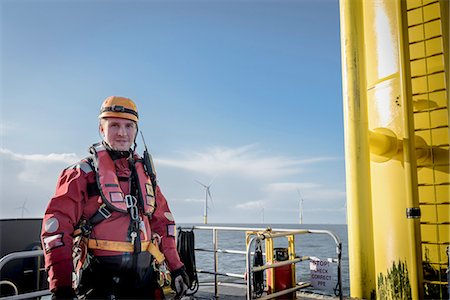 Portrait of engineer at sea at offshore wind farm Stock Photo - Premium Royalty-Free, Code: 649-08145137