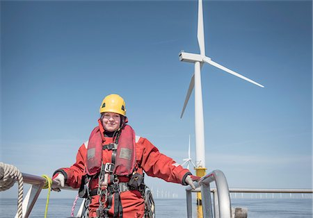 Portrait of female engineer on boat at offshore windfarm Stock Photo - Premium Royalty-Free, Code: 649-08145381