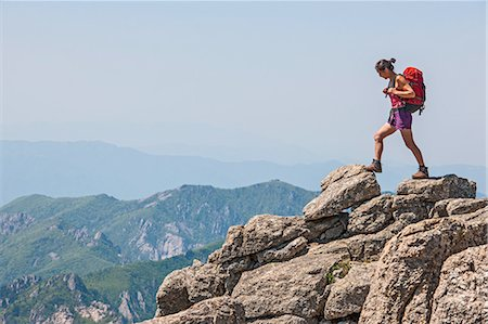 Female hiker stepping on ridge on way to Daecheongbong peak,  Seoraksan National Park in South Korea Stock Photo - Premium Royalty-Free, Code: 649-08145524