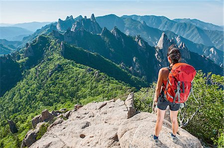 red - Female hiker enjoying the view from ridge at Seoraksan National park, Gangwon, South Korea Stock Photo - Premium Royalty-Free, Code: 649-08145544