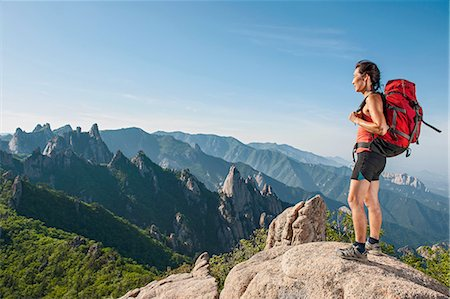 fitness   mature woman - Female hiker looking out from ridge at Seoraksan National park, Gangwon, South Korea Stock Photo - Premium Royalty-Free, Code: 649-08145545