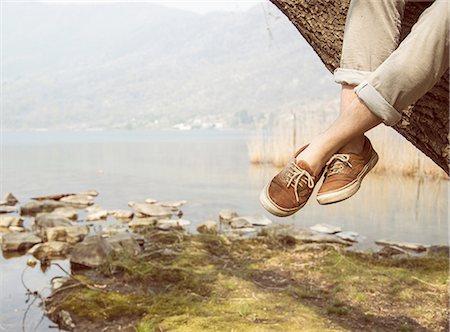 dangling - Mans feet dangling from tree on lakeside, Lake Mergozzo, Verbania, Piemonte, Italy Stock Photo - Premium Royalty-Free, Code: 649-08145634