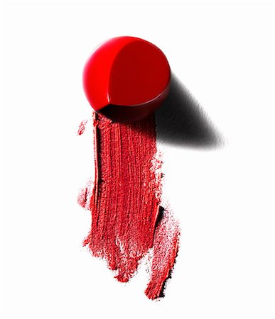 Abstract of piece of red lipstick and smudged line Stock Photo - Premium Royalty-Free, Code: 649-08145723