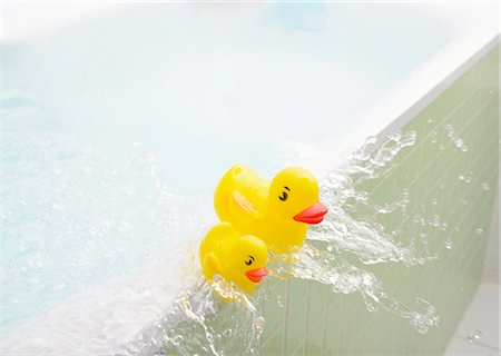 flooded homes - Rubber ducks falling out of bath overflowing with water Stock Photo - Premium Royalty-Free, Code: 649-08179749