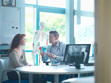 doctor and patient - Orthopaedic consultant with patient in consulting room Stock Photo - Premium Royalty-Free, Code: 649-08179885