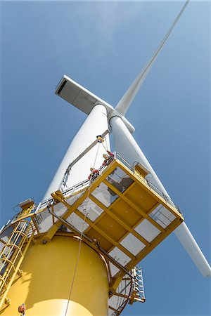 platform - Engineers climbing wind turbine from boat at offshore windfarm, low angle view Stock Photo - Premium Royalty-Free, Code: 649-08179975