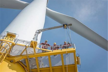 Portrait of engineers on wind turbine at offshore windfarm Stock Photo - Premium Royalty-Free, Code: 649-08179976