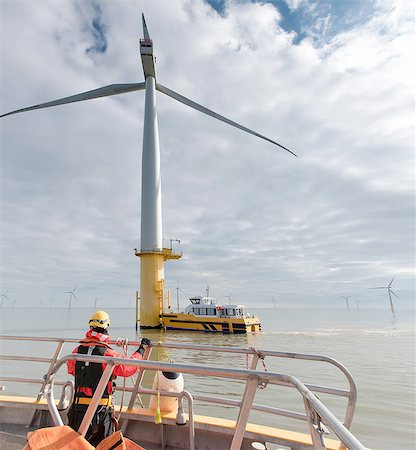 Engineer in boat at offshore windfarm turbine Stock Photo - Premium Royalty-Free, Code: 649-08179971