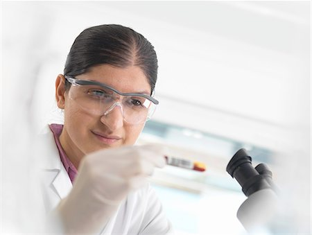 Young woman scientist viewing blood sample during clinical testing of medical samples in a laboratory Stock Photo - Premium Royalty-Free, Code: 649-08180221